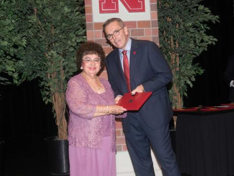Prispa Espinosa from University Housing was honored by Chancellor Ronnie Green for her 45 years of service to the university.