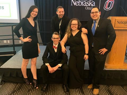 Four Nebraska students pose for a photo with their advisor at the Midwest Affiliate of College and University Residence Halls  conference.