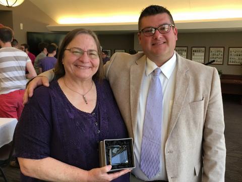 Pat Tetreault of the University of Nebraska-Lincoln accepts the alumnus of distinction award at K-State Lavender Graduation.