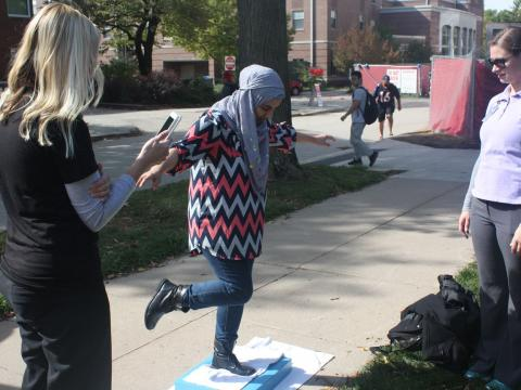 Student participates in balance test at PT Month event at University of Nebraska-Lincoln