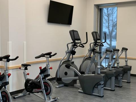 Upright exercise bikes and ellipticals in UNL residence halls' new fitness spaces.
