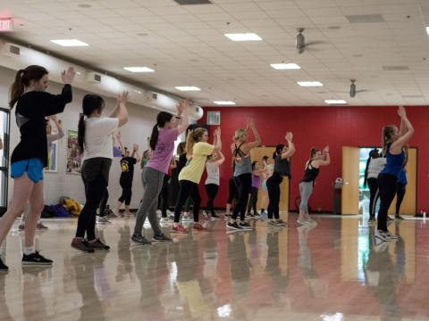 Students participate in a cardio dance class at the Campus Recreation Center on Jan. 9, 2018.
