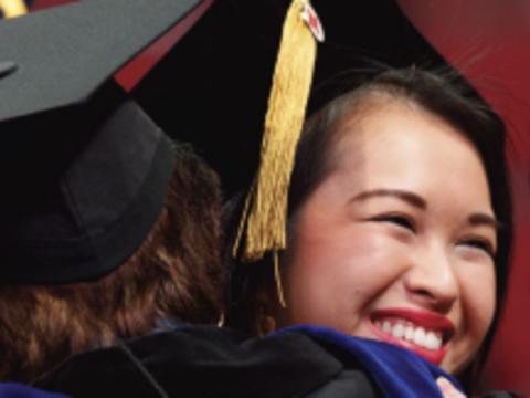 Students hugging at Nebraska commencement