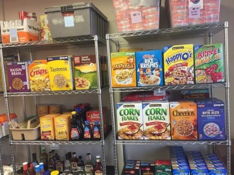 Shelves of packaged foods inside the Husker Pantry.