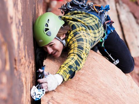 Male student rock climbing in Wichita Mountains. | Photo credit: Doug Lintz.