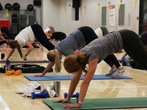 Huskers practice yoga in the Campus Rec Center at the University of Nebraska-Lincoln.